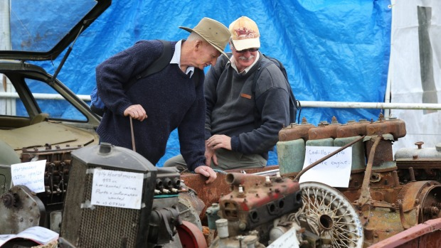 Bill Ward, left, and Chris Dyer fossick about the engine parts for sale at the Winchester Swapmeet. The annual event is organised by the South Canterbury Vintage Car Club.
