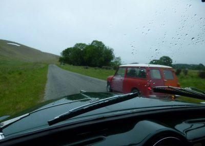 Lex Westoby's Morris Mini Countryman overtakes at Maungati.